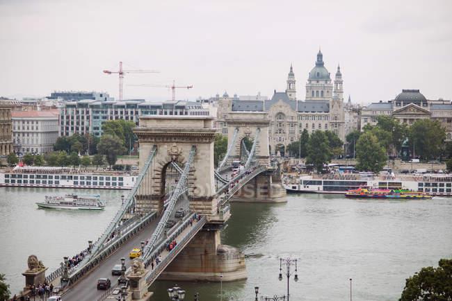 Cityscape with bridge over river — Stock Photo