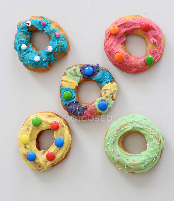 Colorful doughnuts with icing — Stock Photo