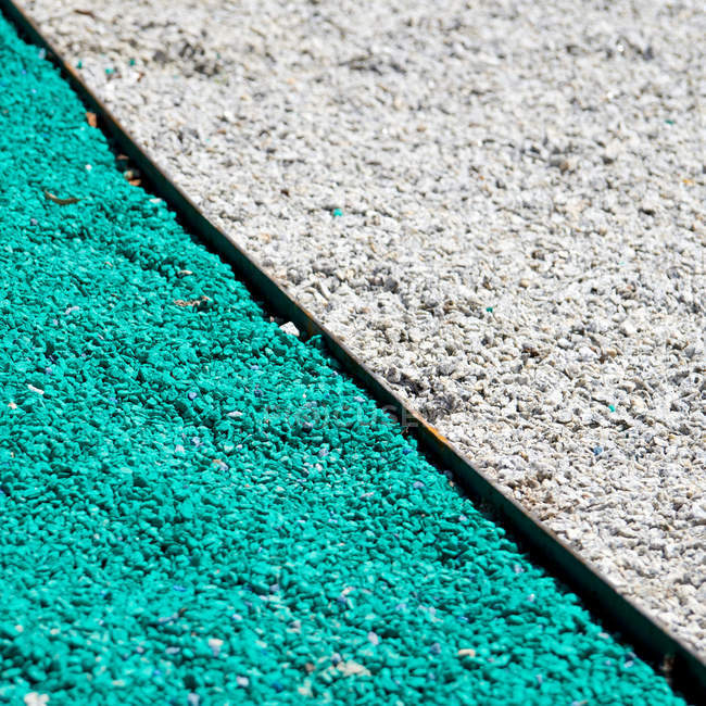 Turquoise and grey gravel road cover — Stock Photo
