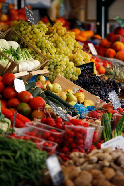 Vegetables and berries in market boxes — Stock Photo