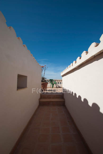 Narrow path to outside terrace — Stock Photo