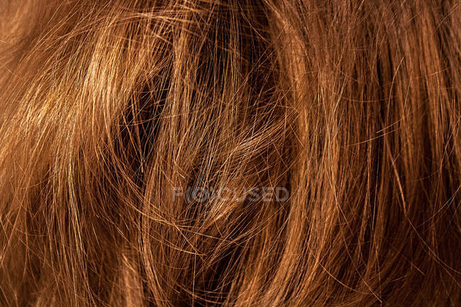 Close-up view of brown curly hair — Stock Photo
