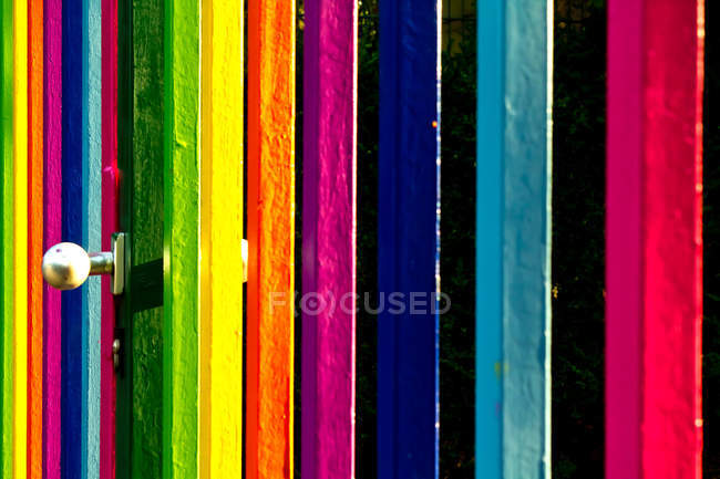 Colorful fence with bright stripes — Stock Photo