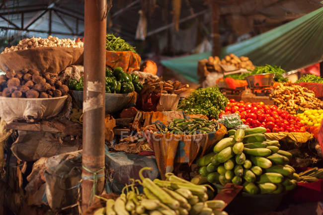 Vegetables and greenery on market counter — Stock Photo