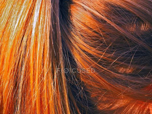 Partial view of woman with red hair, full frame image — Stock Photo