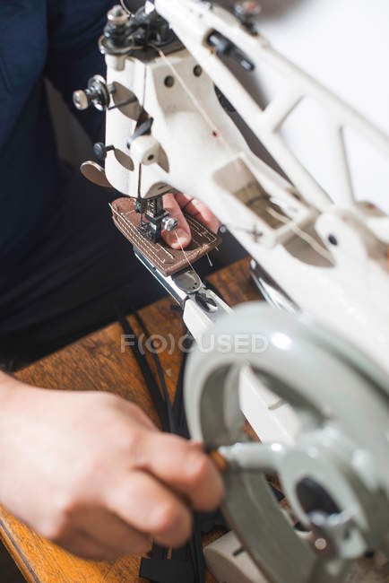 Sewing leather on sewing machine — Stock Photo
