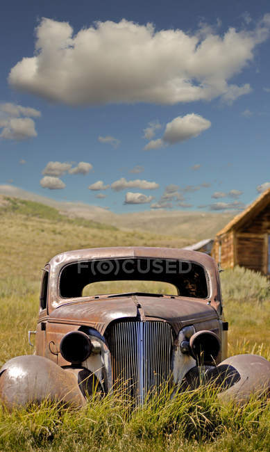 old broken car in field ghost city usa stock photo 158006236