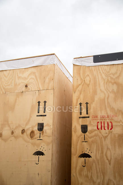 Wooden packaging containers with signs of careful transportation — Stock Photo