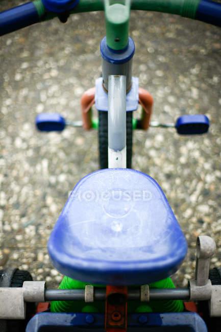 Teilansicht des Kind Dreirad — Stockfoto