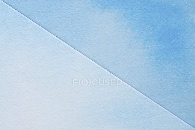 Blue watercolours on textured paper — Stock Photo