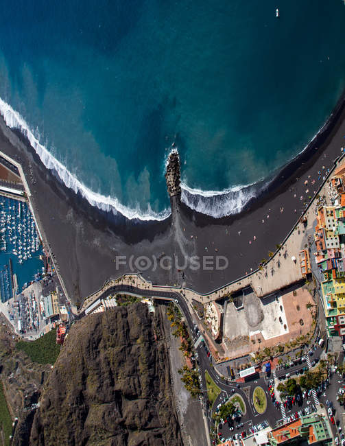 Aerial view on port city at ocean — Stock Photo