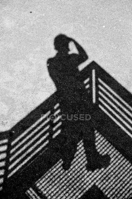 Human shadow on grey asphalt — Stock Photo