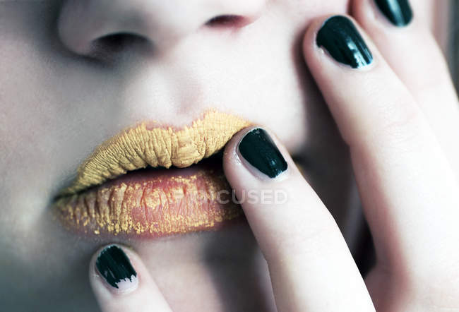 Cropped image of female make up, lips with yellow lipstick — Stock Photo