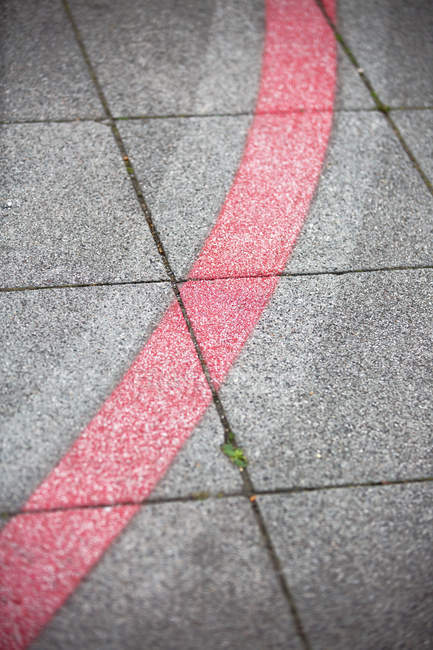 Gray asphalt with red cycle path, dividing line — Stock Photo