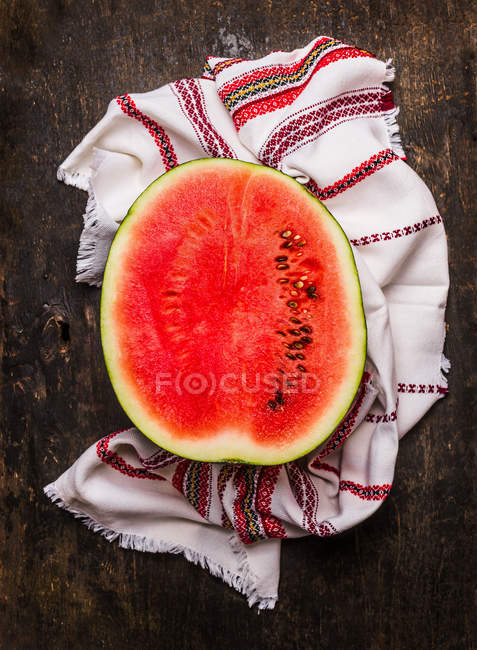 Watermelon half with cloth — Stock Photo