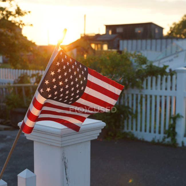American flag at the backyard in sunset — стокове фото