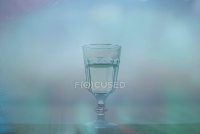 Glass with white wine on blurred background — Stock Photo