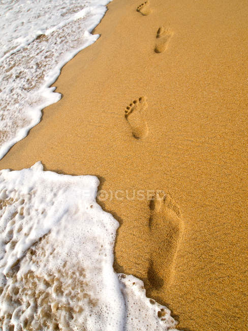 View of human footprints on sand surface — Stock Photo