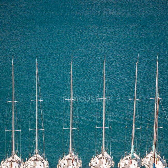 Elevated view of white luxury yachts anchored in harbor — Stock Photo