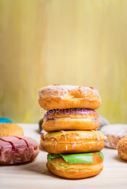 Pile of colorful doughnuts — Stock Photo