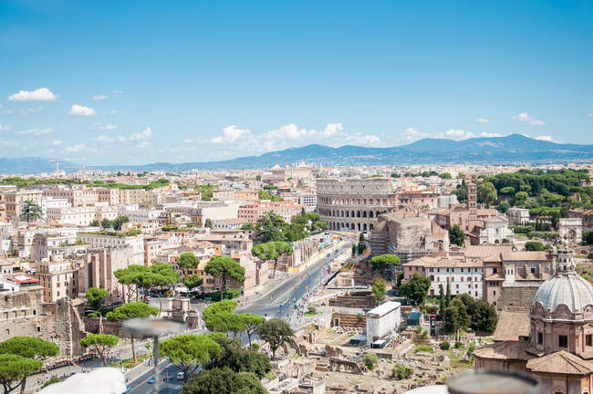 Cityscape of Rome old town with colosseum and ruins, famous touristic destination, Italy — Stock Photo