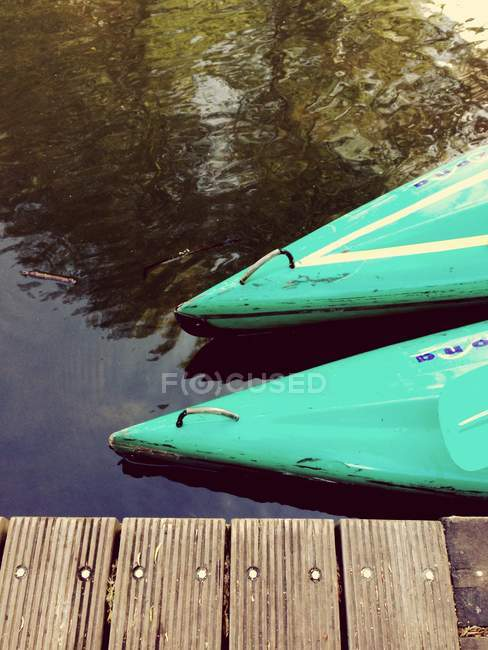 Partial view of row boats at the lake by wooden pier — Stock Photo