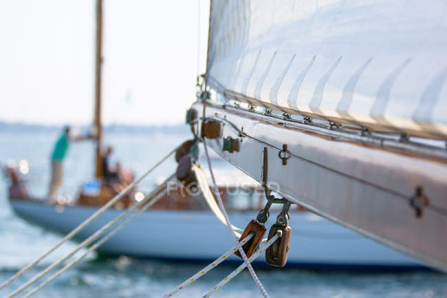 Details of yacht mast with sail, sailboat view on background — Stock Photo