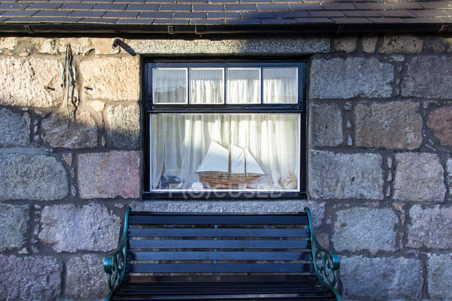 Old fashioned bright window view and ship model on sill, brench outdoors — Stock Photo
