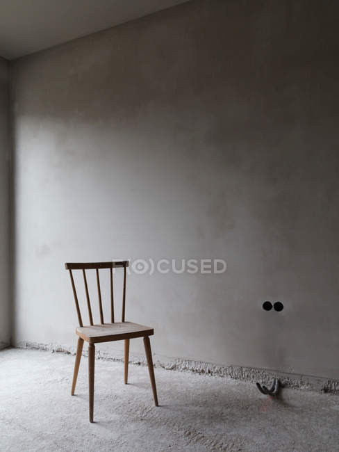 Empty Room With Old Wooden Chair Stock Photo