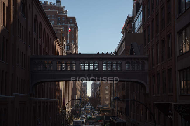 Cityscape with bridge over street — Stock Photo