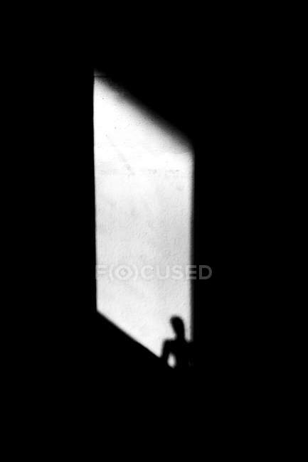 Shadow on wall of window and person silhouette — Stock Photo