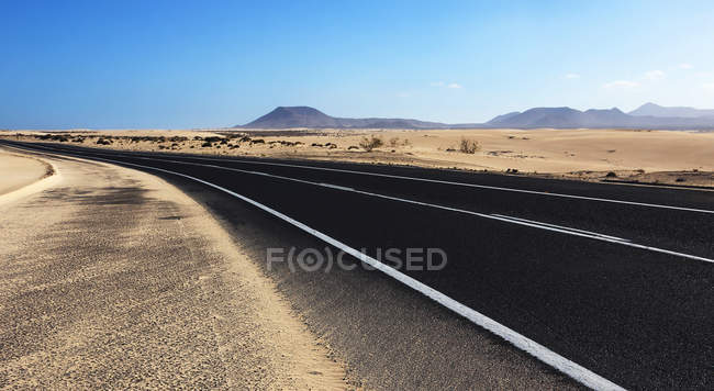 Deserted landscape with highway — Stock Photo