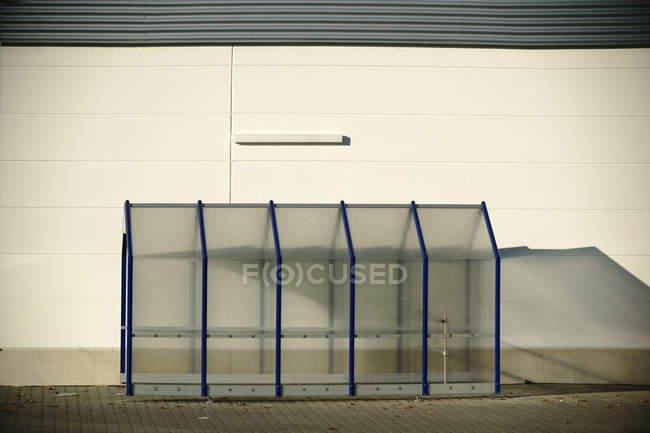 Exterior shot of building and glass bicycle parking — Stock Photo