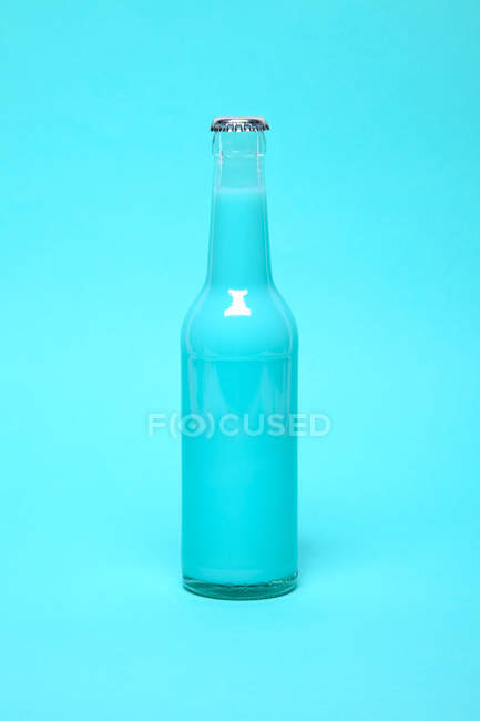 One closed bottle with blue drink — Stock Photo