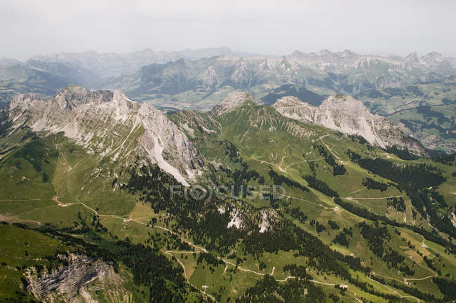 Aerial view of snow covered mountain peaks — Stock Photo