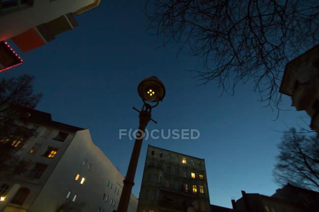 Lighting lantern and buildings — Stock Photo