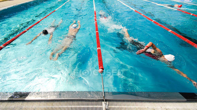Sportive people swimming in swimming pool, competition — Stock Photo