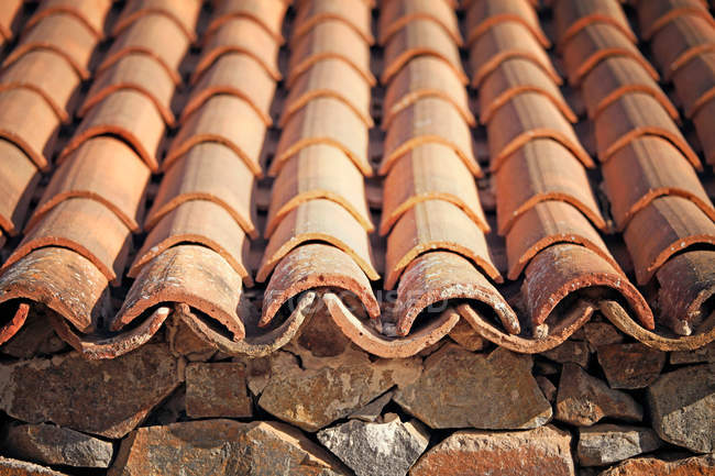 Bricks wall texture and roofing tiles — Stock Photo