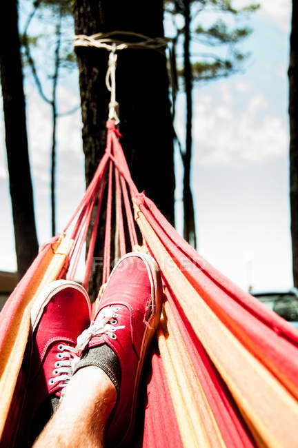 Close-up view of person feet in hammock — Stock Photo