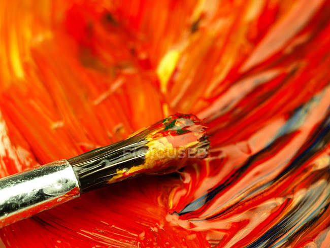 Paints and brush on pallete — Stock Photo