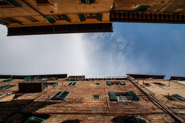 Bottom view of residential buildings, Siena, Italy — Stock Photo
