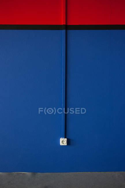 Wall with power socket — Stock Photo