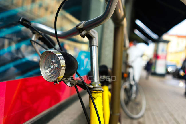 Bicycle handlebar with lamp — Stock Photo