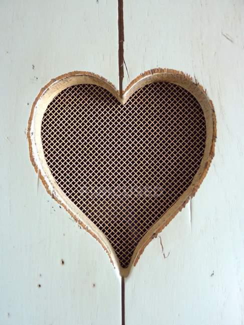 Trou de porte en forme de coeur — Photo de stock