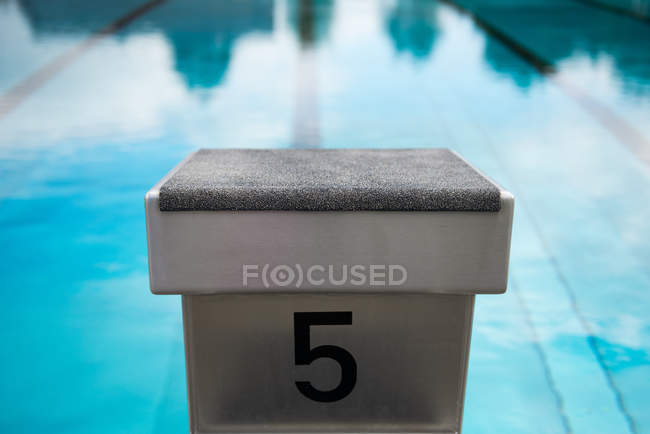 Swimming pool and number five — Stock Photo