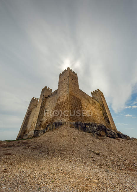 Low angle view of old castle and cloudy sky in Sadaba, Aragon, Spain — Stock Photo