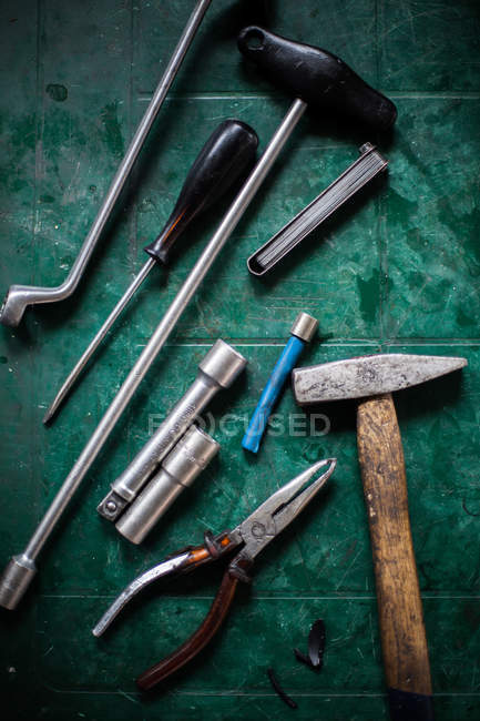Top view of table with hammer and tools — Stock Photo