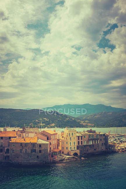 Scenic view with Saint Florent village by the sea, mountains on background, France — Stock Photo