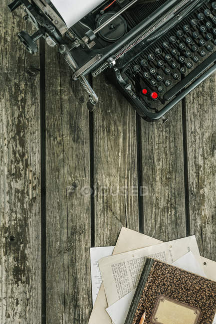 Typewriter on wooden table — Stock Photo
