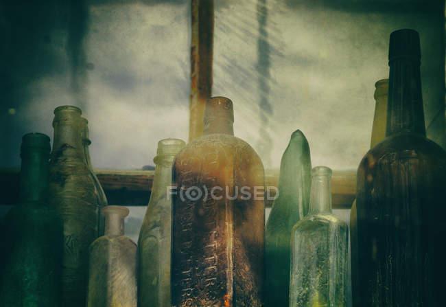 Different Vintage Bottles On Window Sill Stock Photo